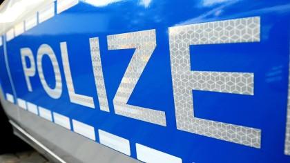 Die Aufschrift an einem Polizeiauto.
